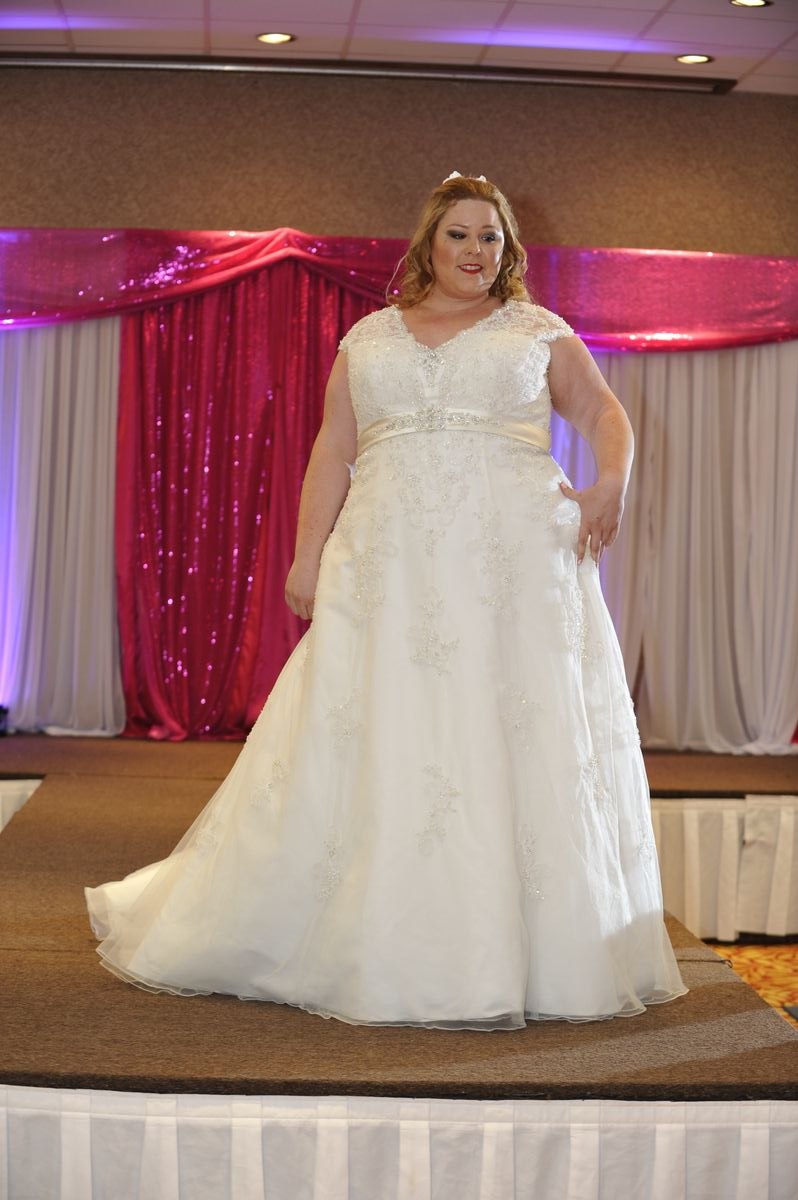 Torrance bridal show plus size wedding gowns on the runway for Plus size beaded wedding dresses