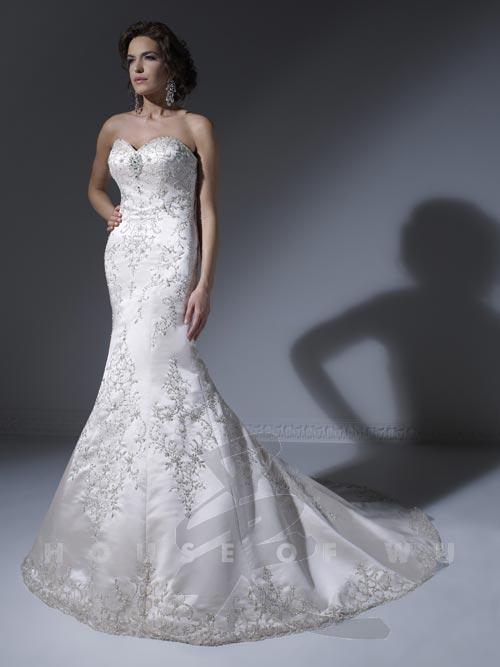 Mermaid wedding dresses with sparkle strut bridal salon for Sparkly beach wedding dresses