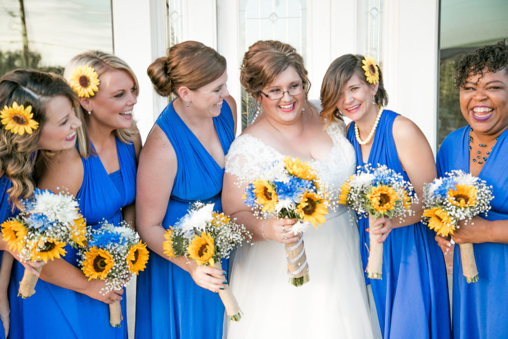We Loved The Pop Of Royal Blue Next To Bobbie S Wedding Dress Don T They Look Awesome Against Pretty Sunflowers