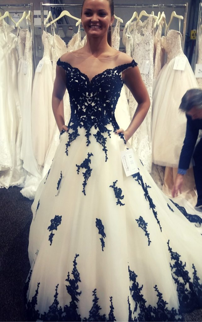 a36c2cd88 This plus size black ballgown wedding dress features an illusion  off-the-shoulder and sweetheart bodice. The bodice also has beaded lace  that trails just ...