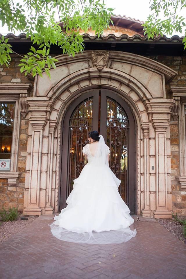 533080e247c The ruffles on that skirt make the back of Elizabeth s stunning custom plus  size wedding dress look fabulous!