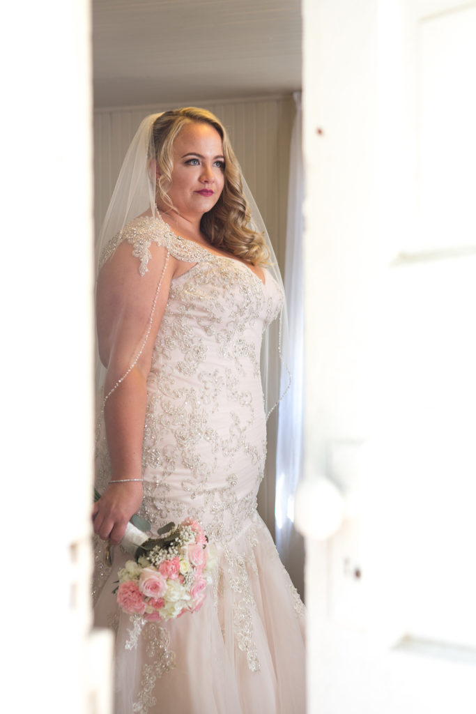 real plus size bride in beaded champagne wedding dress Los Angeles