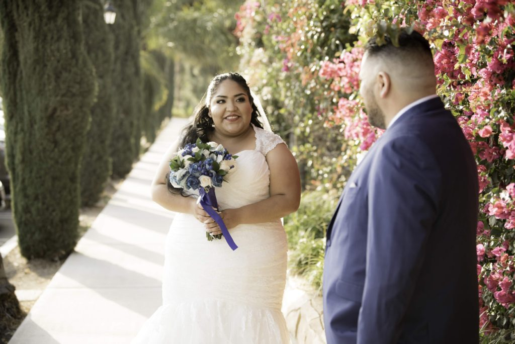 first look on wedding day with real plus size bride