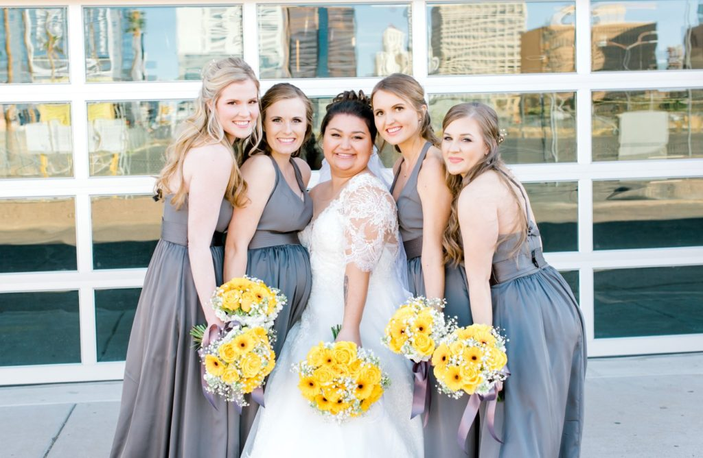 curvy bride and bridesmaids wearing gray