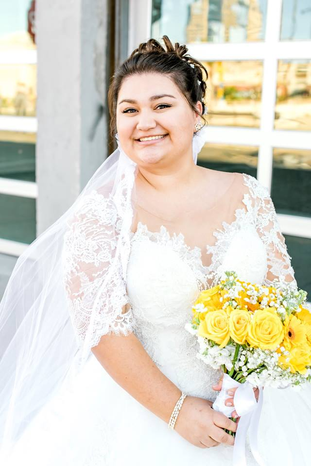 beautiful plus size bride wearing lace wedding dress with sleeves