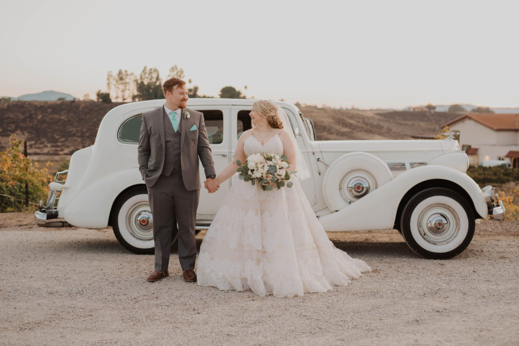 vintage car rental newlyweds plus size wedding dress