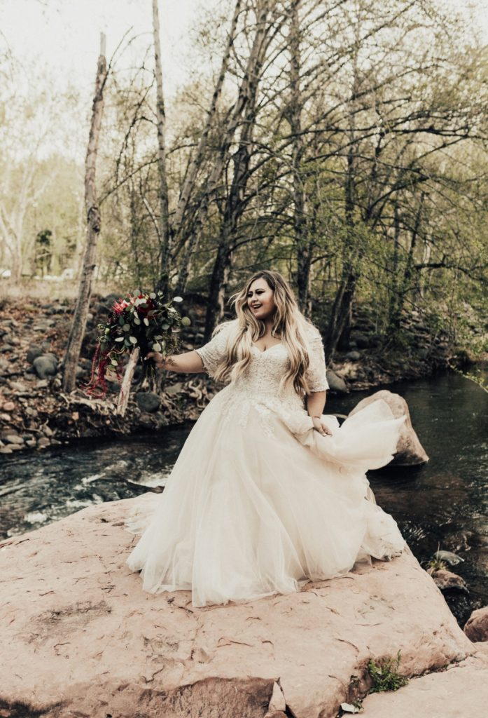 plus size bride wearing ballgown wedding dress with sleeves