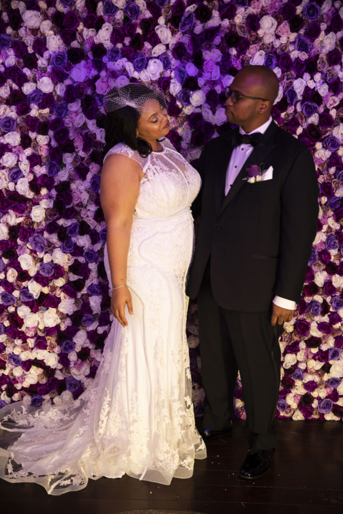 plus size bride wearing a sexy beaded fitted wedding gown