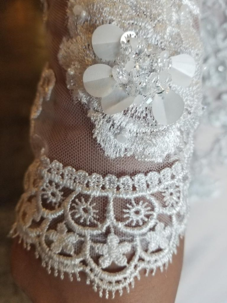 lace and beaded long sleeve wedding dress