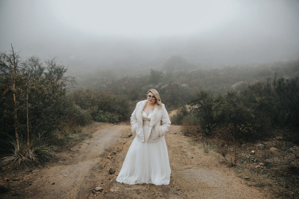 sassy plus size bride in custom wedding dress with fur coat