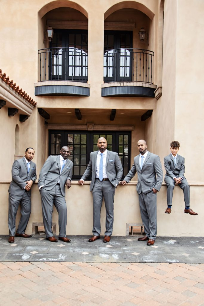 groomsmen in gray suits with blue ties
