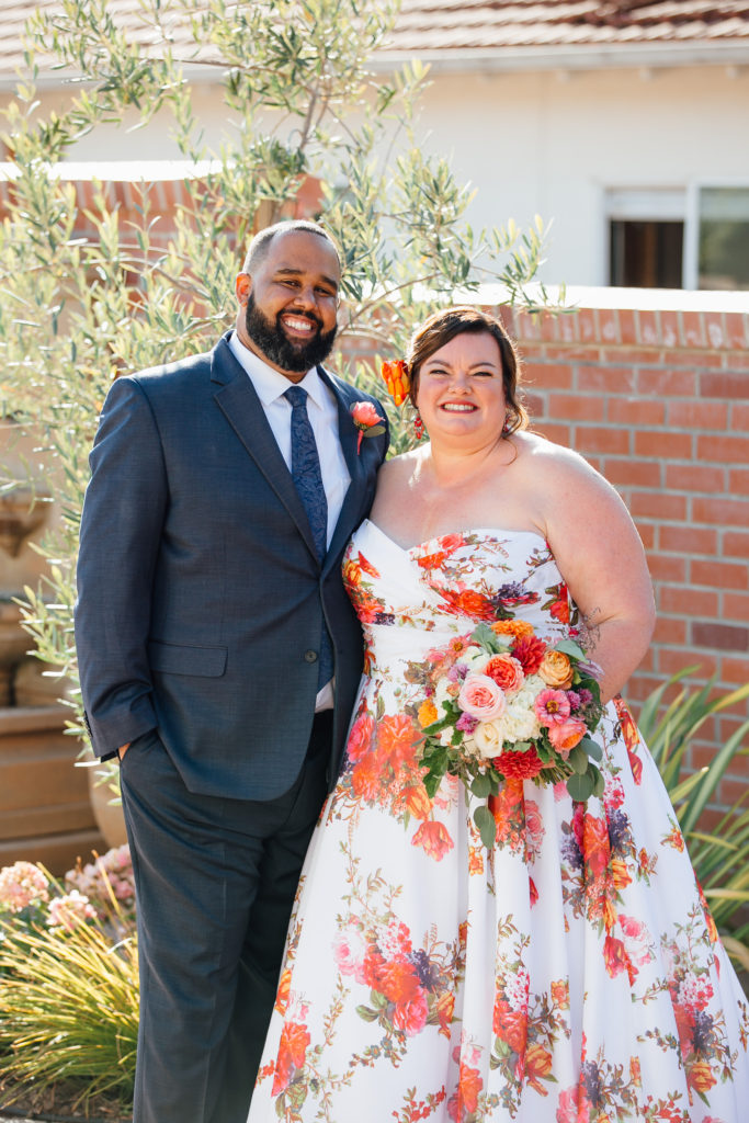 newlyweds real bride wearing floral wedding dress