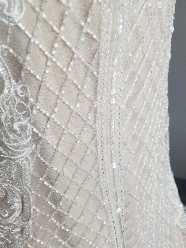 close up of hand sewn beading on wedding dress