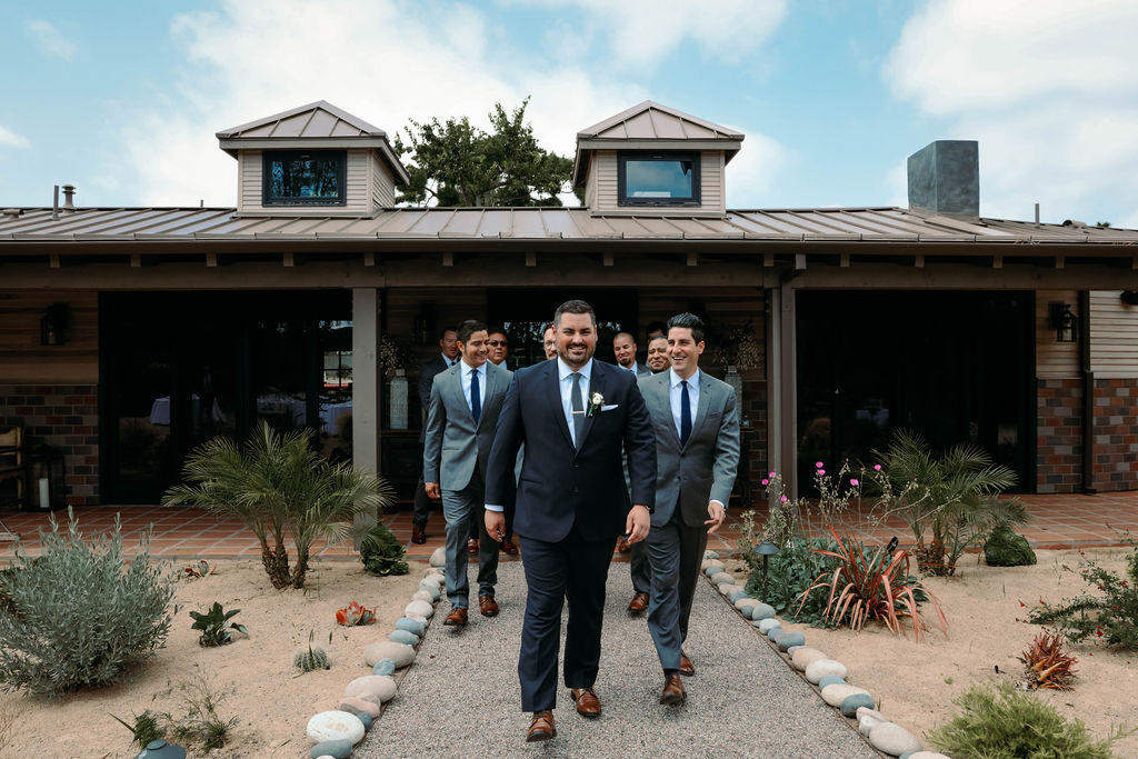 groomsmen and groom wearing suits