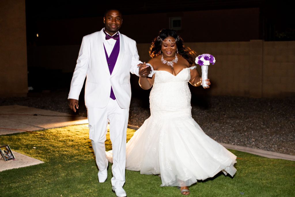 groom in white suit and plus size bride in lace mermaid wedding dress